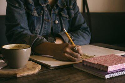 A woman writing.